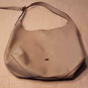 Michael Kors gray leather bag.